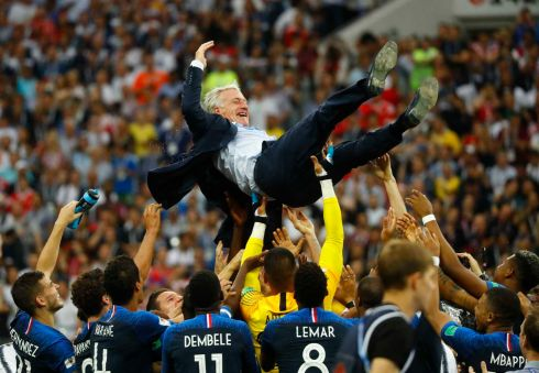 France players celebrate winning the World Cup with coach Didier Deschamps REUTERS/Kai Pfaffenbach