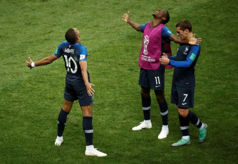Kylian Mbappe celebrates scoring their fourth goal with Antoine Griezmann and Ousmane Dembele   REUTERS/Christian Hartmann