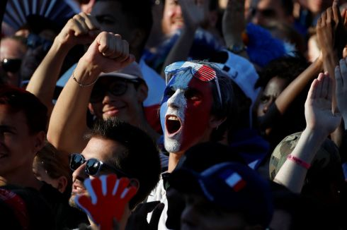 France fans react as they watch the match at a fan zone.   REUTERS/Eric Gaillard
