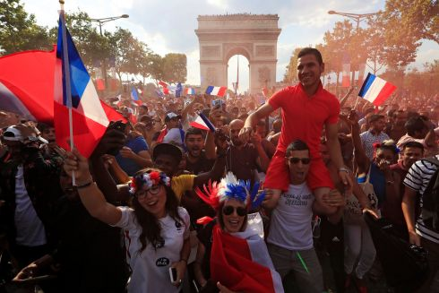 France fans react on the Champs-Elysees avenue after they defeated Croatia in their Soccer World Cup final match.   REUTERS/Gonzalo Fuentes