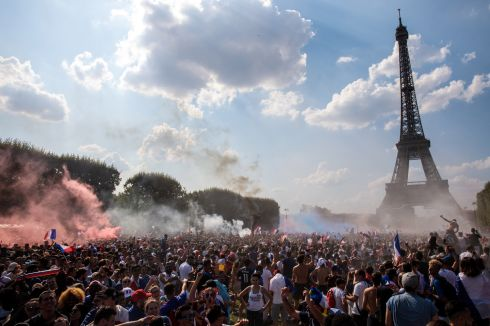 French football fans celebrate in the Champs-de-Mars fan zone as France score their first goal against Croatia in the FIFA 2018 World Cup Final match on July 15, 2018 in Paris, France.  Photo Jack Taylor/Getty Images