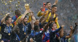 Olivier Giroud lifts the World Cup trophy as thre french players celebrate their World Cup final win over Croatia at the Luzhniki Stadium in Moscow. Photograph: Damir Sagolj/Reuters