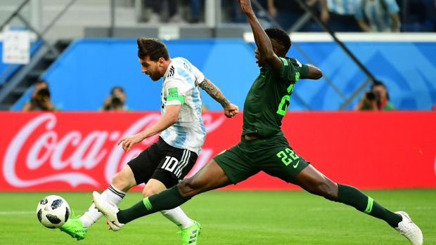 Lionel Messi scores against Nigeria. Photograph: Giuseppe Cacace/AFP/Getty