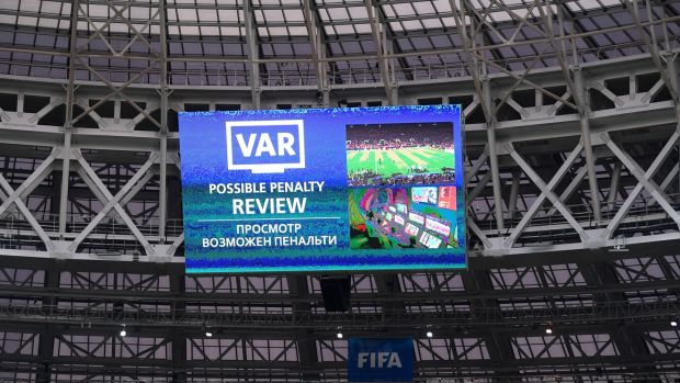 The big screen at the Luzhniki displays a VAR review during the World Cup final. Photograph: Laurence Griffiths/Getty
