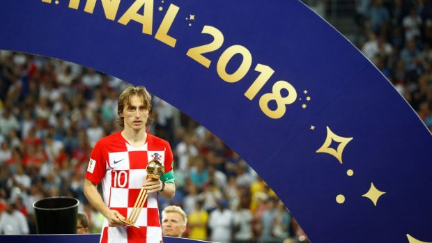 Luka Modric receives the Golden Ball award. Photograph: Kai Pfaffenbach/Reuters