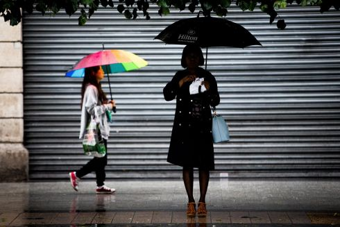 BACK TO REALITY: Familiar Irish summer weather reasserts itself on O'Connell Street in Dublin after what has seemed like an unprecedented heatwave across Ireland over many weeks. Photograph: Tom Honan/The Irish Times