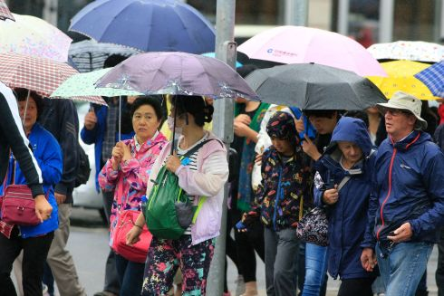 WELCOME RESPITE: Rain makes its return felt in Dublin city centre after what has been a lengthy heatwave. Photograph: Nick Bradshaw/The Irish Times