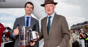 Patrick Mullins pictured with his father Willie. Photograph: Morgan Treacy/Inpho