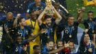 The France team celebrating after lifting the World Cup in Moscow. Photograph:  AFP Photo/Adrian Dennis