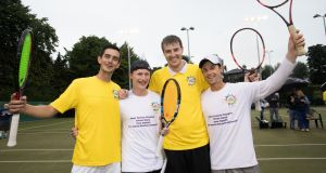 Dan O'Neill, Luke Maguire, James Cluskey and David Mullins celebrate after their Guinness World Record attempt at Fitzwilliam Lawn Tennis Club in Dublin. Photograph: Tom Honan