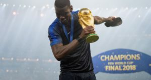 Paul Pogba celebrates with the World Cup trophy in Moscow. Photograph: Matthias Hangst/Getty