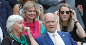 Conservative Party MP and former cabinet minister Justine Greening (in pink) sits with Pamela Castle, as former Conservative Party leader William Hague speaks to Mary Cameron, mother of former Prime Minister David Cameron in the Royal Box on Centre Court at Wimbledon. Photograph: Peter Nicholls/Reuters