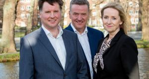 Morgan McKinley chief executive Aldagh McDonogh (right); company founder Pat Fitzgerald (centre); and chief financial pfficer Shane Doherty (left).