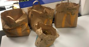 The offering contained within four bags to feed 189 people included McDonald's hamburgers and Haribo