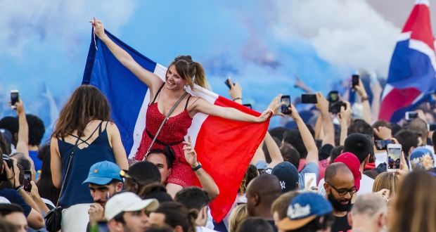 France celebrates its World Cup heroes amid surge in