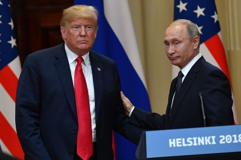 HIGH STAKES: Donald Trump and Vladimir Putin at the end of their joint press conference. Mr Trump said he saw no reason to believe Russia had hacked the 2016 US presidential election to help him win it. Photograph: Yuri Kadobnov/Getty Images