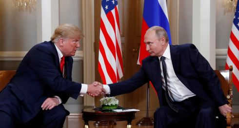 BIG ISSUES: US President Donald Trump shakes hands with Russian President Vladimir Putin in Helsinki, Finland. The press conference af their summit leaves serious questions unresolved. Photograph: Kevin Lamarque/Reuters