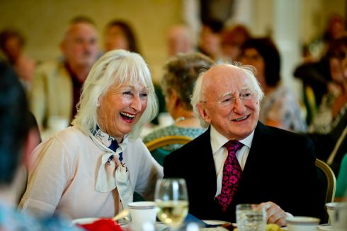 TEA PARTY: President Michael D Higgins hosts afternoon tea for community groups at Áras An Uachtaráin in the Phoenix Park. Here the president meets Deena Cotter of Dún Laoghaire during the tea party.  Photograph: Maxwell's