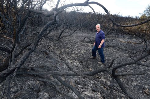 BURNT OUT: Mark Kopik on his land at Bray Head, Co Wicklow, which was ravaged by a gorse fire over the weekend after the extended heatwave period. Photograph: Cyril Byrne/The Irish Times