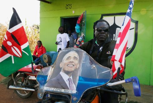 'WELCOME HOME': A local displays a poster of Barack Obama on his motorbike ahead of a visit by the former US president to his ancestral village of Nyangoma Kogelo in Siaya county, western Kenya. Photograph: Thomas Mukoya/Reuters