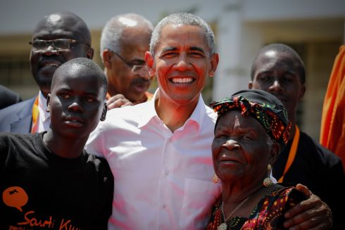 HELPING HAND: Former US president Barack Obama with his step-grandmother Sarah Onyango Obama and an unidentified local student (left), during an opening ceremony for the Sauti Kuu Sports, Vocational and Training Centre at his ancestral home of Kogelo, some 400km west of the Kenyan capital of Nairobi. The centre was founded by Mr Obama's  half-sister, Auma Obama. Photograph: Dai Kurokawa/EPA
