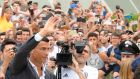 Cristiano Ronaldo waves as he arrives at the Juventus medical centre in Turin. Photograph: Reuters