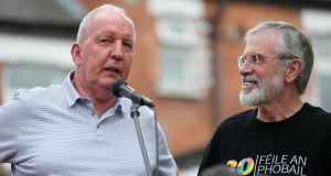 Bobby Storey (left) and Gerry Adams address a rally on Monday night beside the old Andersonstown police station, Belfast, following attacks on their homes last week. Photograph: Niall Carson/PA Wire