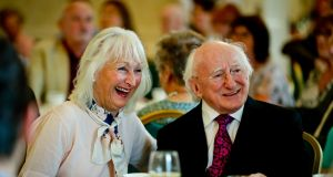 President Michael D Higgins meeting with Deena Cotter from Dún Laoghaire  during the afternoon tea party in Áras an Uachtaráin on Monday. Photograph:  Maxwell's