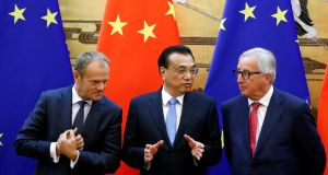 European Council president Donald Tusk, Chinese premier Li Keqiang and European Commission president Jean-Claude Juncker in the Great Hall of the People in Beijing on July 16th. Photograph: Thomas Peter/Reuters