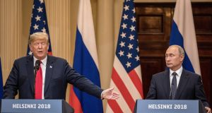 President Donald Trump  and Russian president Vladimir Putin answer questions about the 2016 US election collusion during a joint press conference after their summit  in Helsinki. Photograph: Chris McGrath/Getty Images