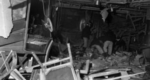 Firemen search through debris in the heart of Birmingham after bombings in two pubs in November 1974. Photograph: Press Association
