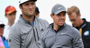 Rory McIlroy and Jon Rahm during practice ahead of the British Open. Photograph:  Stuart Franklin/Getty