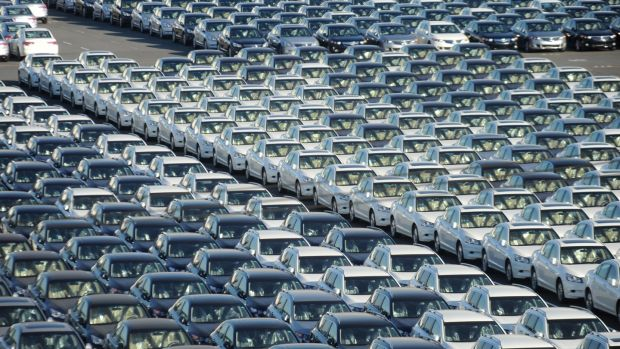 Japanese cars ready for export stand in line at Yokohama port, near Tokyo. Photograph: Everett Kennedy/EPA