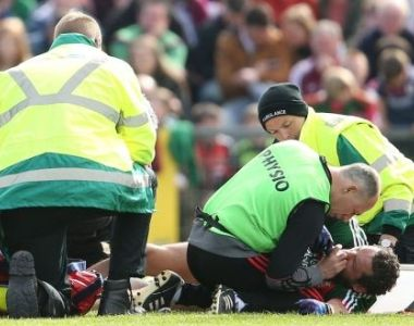 Horror of horrors: Mayo footballer Tom Parsons is treated by medical staff after his injury against Galway. Photograph: Cathal Noonan/Inpho