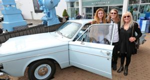 Frances Bean Cobain, daughter of Kurt Cobain, his mother, Wendy O'Connor and sister Kim Cobain pictured this morning with Kurt's Dodge Dart car at the Newbridge Museum of Style Icons where the Cobain family opened an exhibition 'Growing Up Kurt Cobain'. The exhibition runs until 30th September 2018. Photograph: Colin Keegan/Collins Dublin
