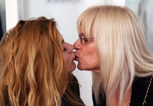 Frances Bean Cobain and Wendy O'Connor kiss at 'Growing Up Kurt Cobain' exhibition. Photograph: Colin Keegan/Collins Dublin.