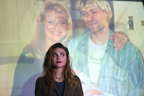 Frances Bean Cobain poses for a photograph in front of a home movie of Kurt. Photograph: Clodagh Kilcoyne/Reuters