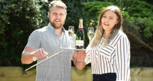 Lotto winners Arron Walshaw and Ceri Hall celebrating their good fortune with champagne. Photograph: Influential/PA Wire