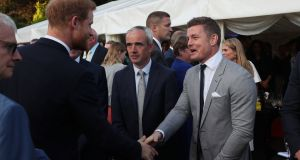The Duke of Sussex (left) chats to former Leinster and Ireland rugby star Brian O'Driscoll at a summer party in the British ambassador's Glencairn House  residence during the recent royal visit. Photograph: Brian Lawless/PA