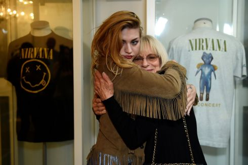 COME AS YOU ARE: Kurt Cobain's daughter Frances Bean Cobain hugs her grandmother Wendy O'Connor (the late grunge star's mother) at the opening of the Growing Up Kurt exhibition, featuring personal belongings of the Nirvana frontman, at the museum of Style Icons in Newbridge, Co Kildare. Photograph: Clodagh Kilcoyne/Reuters