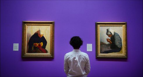 SUMMER EXHIBITION: Aislinn Lynch observes two pieces featuring in the National Gallery of Ireland's summer 2018 exhibition, 'Roderic O'Conor and the Moderns. Between Paris and Pont-Aven'. At left is  Breton Peasant Woman Knitting (1893), and at right, Young Breton Peasant Woman (c.1892). Photograph: Bryan O'Brien/The Irish Times