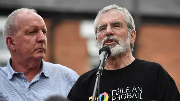 Gerry Adams (right) attends a rally alongside Bobby Storey called in support of the former Sinn Féin president on Monday in Belfast after explosive devices were thrown at the men's homes. Photograph: Getty