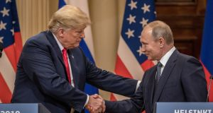 US president Donald Trump  and his Russian counterpart Vladimir Putin shake hands during a joint press conference after their summit in Helsinki on Monday. Photograph:  Chris McGrath/Getty Images