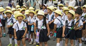 Japanese first-graders in Kyoto. Photograph: Davor Lovinic/iStock