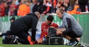 Alex Oxlade-Chamberlain of Liverpool is treated for an injury during the Champions League semi-final first leg clash with Roma. Photo: Marc Atkins/Offside/Getty Images