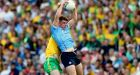Brian Howard fields a ball despite the challenge from Donegal's Eoghan Bán Gallagher during the clash at Croke Park.  Photograph: James Crombie/Inpho