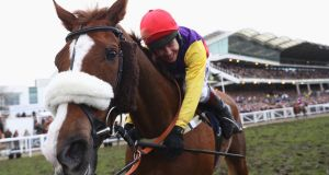 Richard Johnson hugs Native River after winning the Cheltenham Gold Cup Chase during last March.