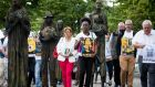 Members of All Together in Dignity Ireland walk through the Famine Statues as part of a commemoration of 100th anniversary of the birth of Nelson Mandela. Photograph: Tom Honan