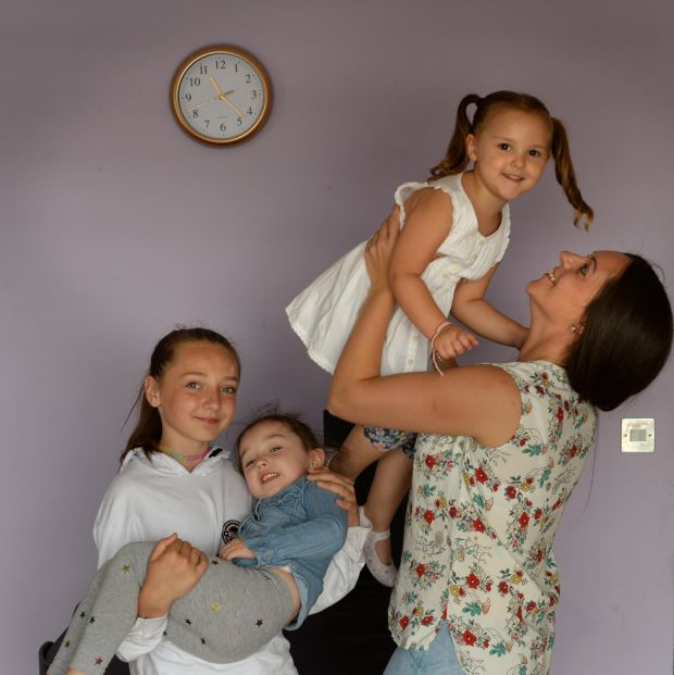 Sarah Conway with her children Kyra (11), Amelia (4) and Hallie (3) at home in Cork Street, Dublin. Photograph: Dara Mac Dónaill