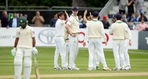 Ireland celebrate the dismissal of Asad Shafiq bowled by Tim Murtagh during the first Test match at Malahide last May. Photo: Oisin Keniry/Inpho